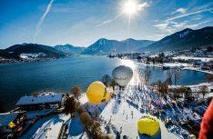 Etwa 20 Heißluftballons in ausgefallenen Formen und Farben starten in Rottach-Egern täglich zur 18. Tegernsee Tal Mongolfiade. (Foto: Tegernsee Tourismus)