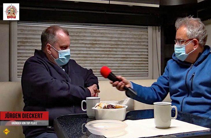 TopPlatz-Chef Jürgen Dieckert (links) wird von Uwe Dietz, www.abenteuer-reisemobil.de, zur aktuellen Situation des Wohnmobil-Tourismus befragt. (Foto: Screenshot D.C.I.)