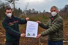 Die Spendenurkunde mit der Spende von 300 Bäumen für den Kottenforst. (Foto: det / D.C.I)